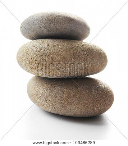 Grey spa stones, isolated on white