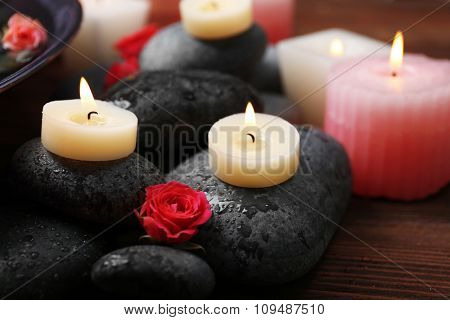 Spa composition of flowers, candles and stones, close-up