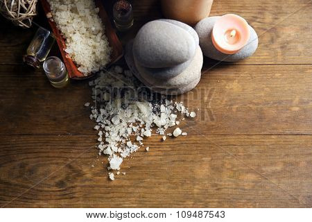 Beautiful relax composition with candles and pebbles on wooden background, close up