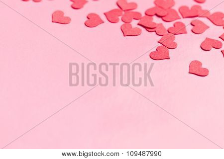 paper hearts on pink background