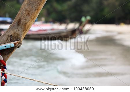 Fishing Thai boat standing at the shore.