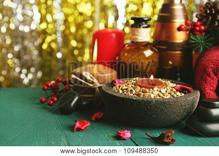 Beautiful Christmas presents composition on green wooden table against sparkle background