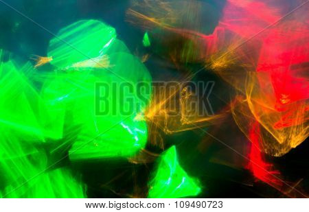 holidays, illumination and electricity concept - colorful bright night lights bokeh over dark background