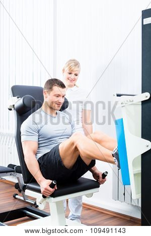 Patient at the physiotherapy doing physical exercises using leg press in sport remobilization
