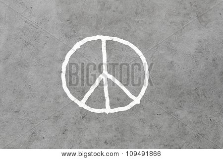symbolic, pacifism and hippie concept - peace sign drawing on gray concrete wall