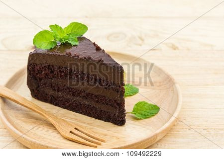 Chocolate Cake Slice In Wooden Plate.