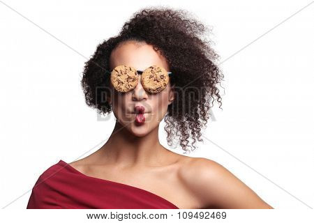 Weird, crazy. Woman with glasses made out of cookies