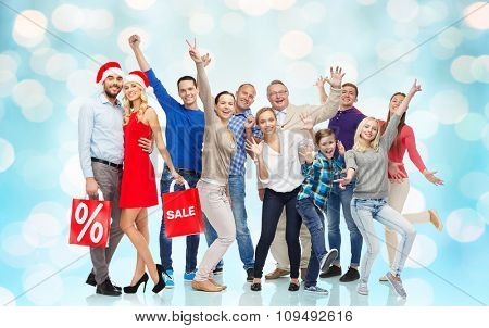 sale, discount, happiness and people concept - happy people with shopping bags having fun
