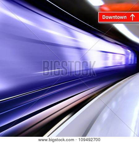 super streamlined train with motion blur moves in subway