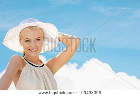 fashion, happiness and lifestyle concept - beautiful woman in hat enjoying summer outdoors