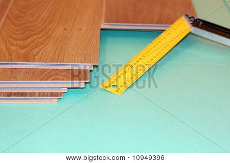 ruler and laminate on substrate