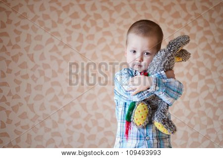 Little Boy Is Holding His Teddy  Rabbit
