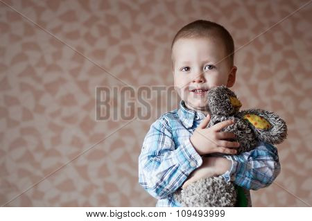 Little  Boy Smiling Is Holding His Teddy  Rabbit