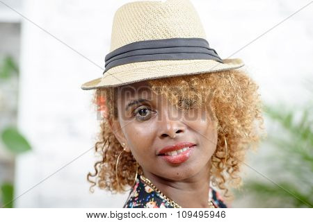 Portrait Of A Young African Woman With A Hat