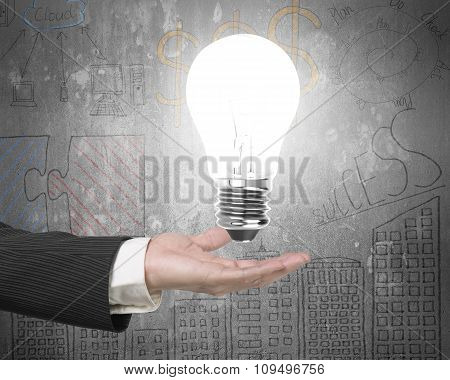 Human Hand Holding Lightbulb With Bright Light