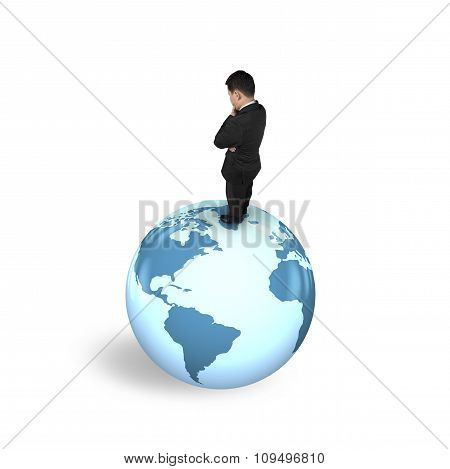 Thinking Businessman Standing On Globe World Map