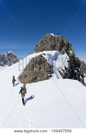 Snowboarders walking uphill for freeride, extreme sport