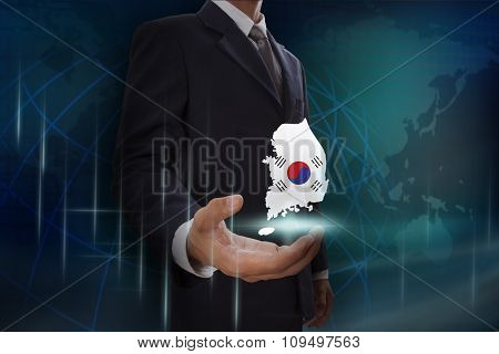 Businessman showing map of Australia on globe background