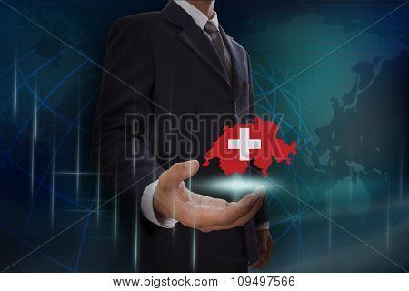 Businessman showing map of Switzerland on globe background
