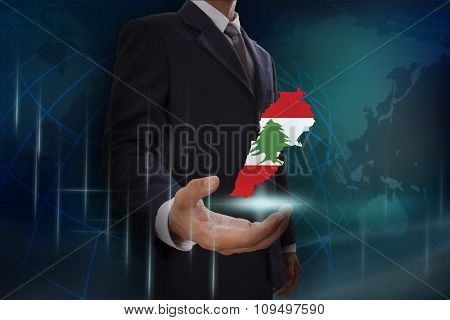 Businessman showing map of Lebanon on globe background