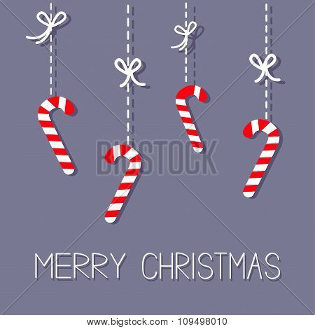 Merry Christmas Hanging Candy Cane. Dash Line With Bow. Flat Design. Violet Background.