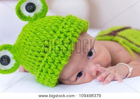 Portrait Of Newborn Baby Girl Sleep On The Bed