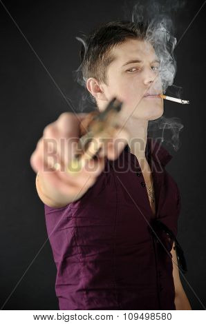Rude  Man With A Cigarette In His Mouth Aiming A Gun