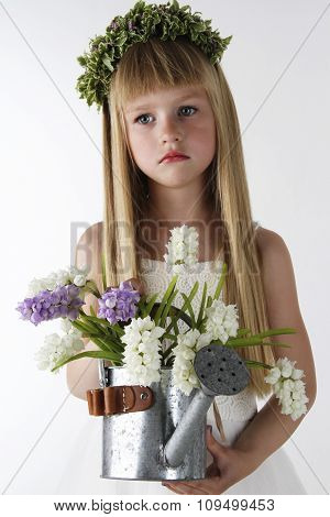 portrait of the beautiful little girl with a bouquet of flowers