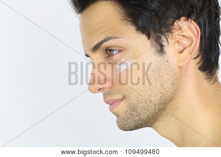Close portrait of a man with moisturizer on her face