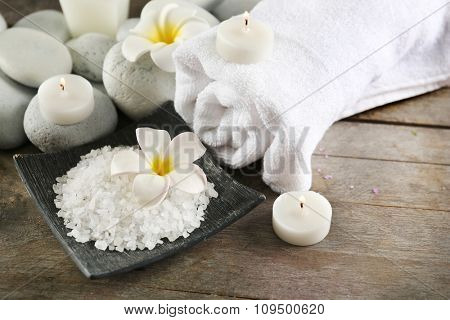Spa still life with white flower on wooden table, closeup