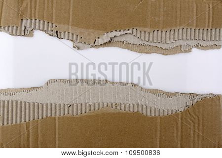 Hole ripped in corrugated cardboard