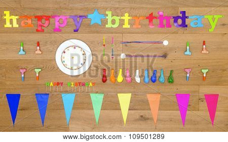 happy birthday themed background image, with an array of items and objects on a wooden surface, including candles, cake, balloons, garlands and party gifts
