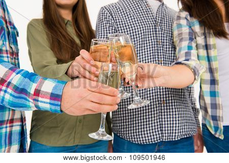 Group Of Young People Celebrating Event With Champagne