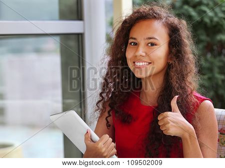 Close up portrait of beautiful young woman with tablet