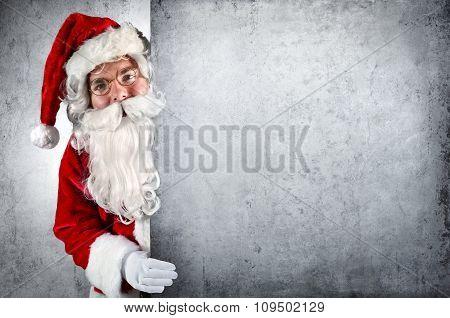 Santa Claus Showing Behind Whiteboard