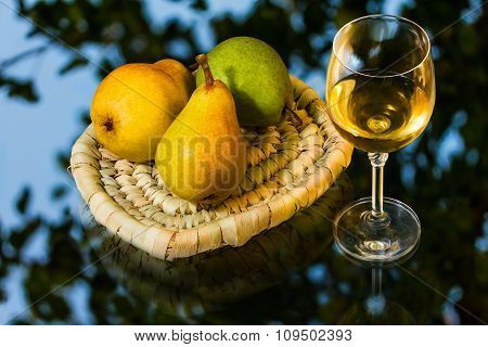 Ripe Appetizing Pears And Glass Of Wine