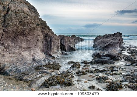 Stormy Sea On A Rocky Beach