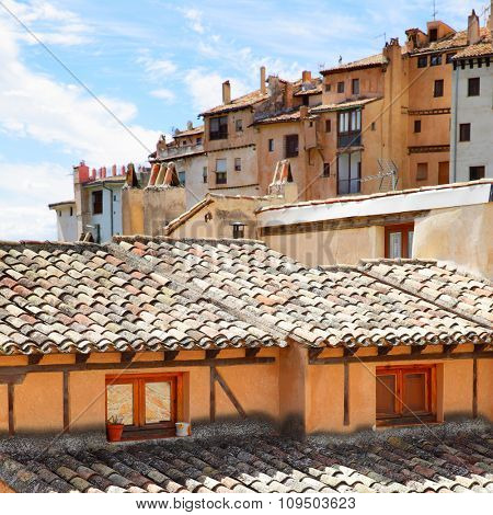 Old roofs and houses on the slope in Cuenca, Spain.