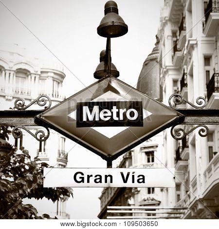 Metro sign (Gran Via) in Madrid. Retro toned image