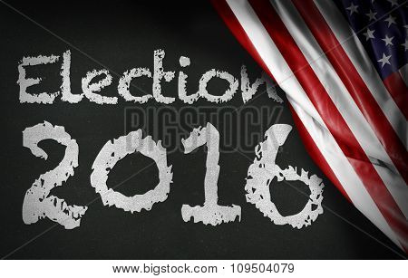 Election 2016 written on blackboard and the USA flag