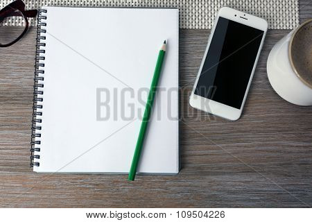 Decorated workplace with opened notebook on wooden table