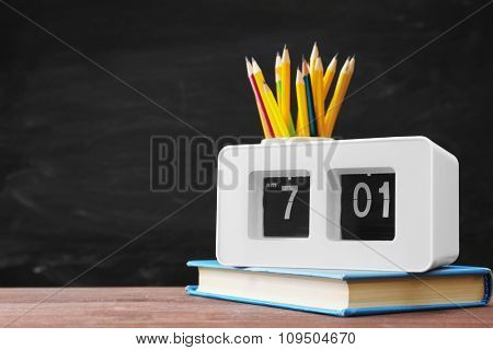 School equipment on blackboard background