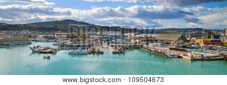 Panorama with harbor of Ancona, boats docked and city
