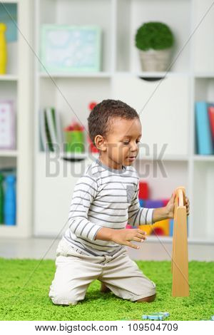 Little boy playing in the children room
