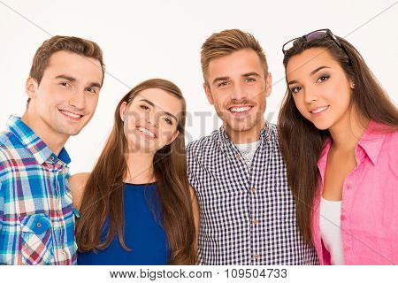 Cheerful Teen People Embracing Each Other