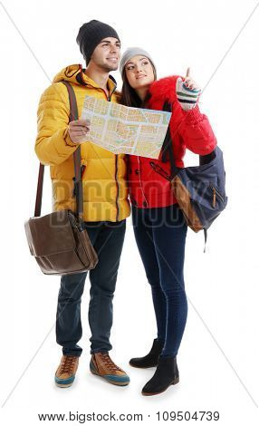 A pair of happy tourists sightseeing in winter, isolated on white