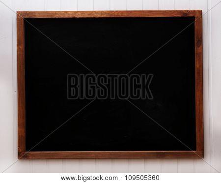 Blank old blackboard on the wall