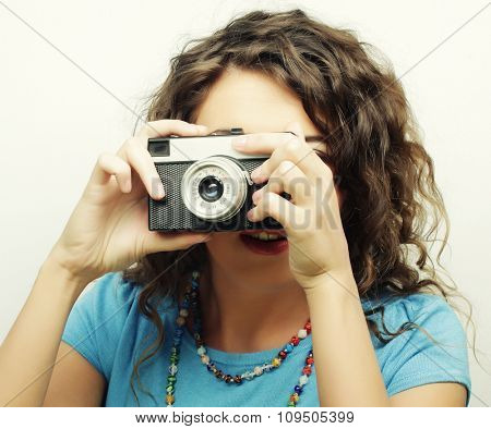 young happy curly woman with vintage camera