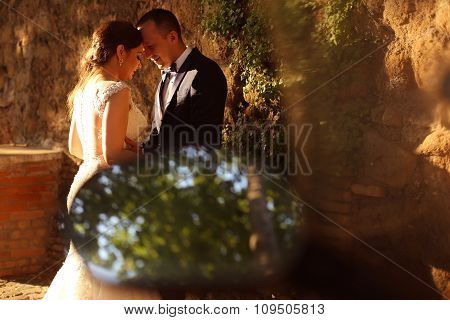 Beautiful Bridal Couple Embracing At Sunset Outdoors