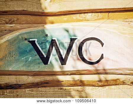 Sign Wc On The Wooden Background
